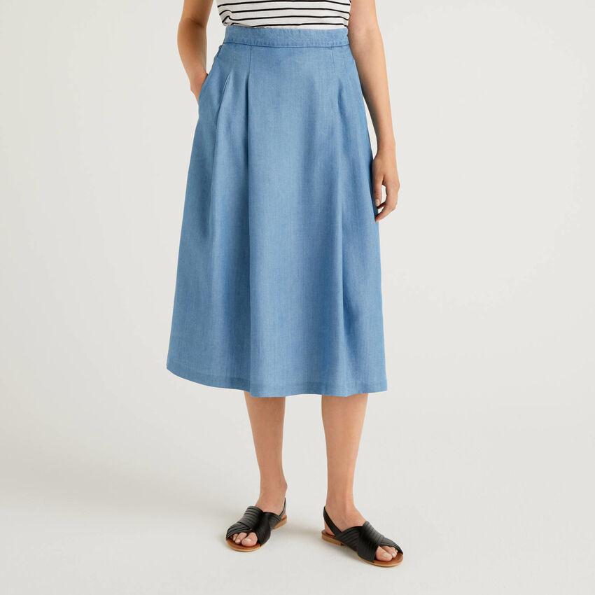 Wide denim look skirt.