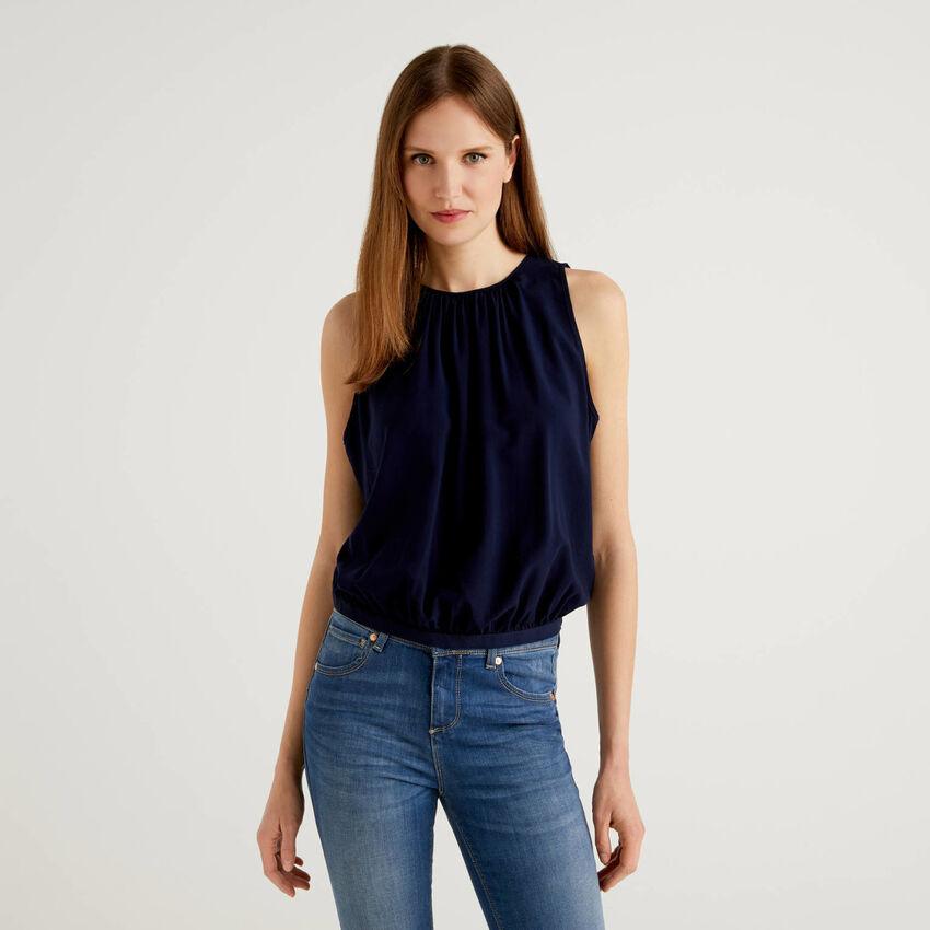 Sleeveless blouse with rouching