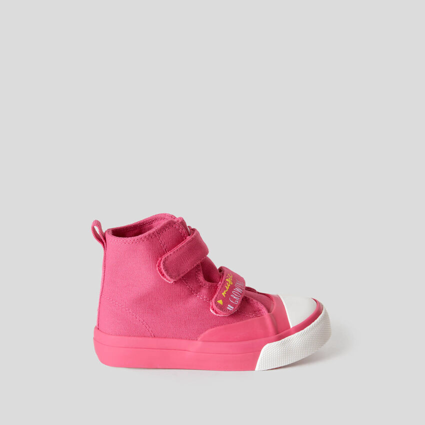 High sneakers with strap closure