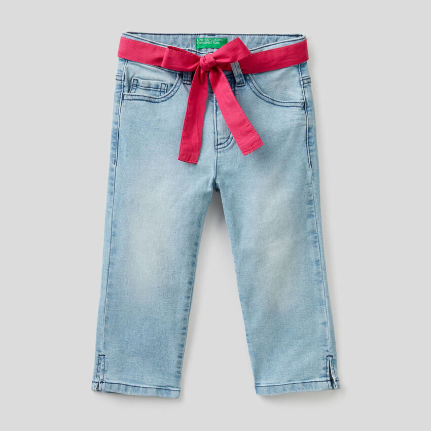 Stretch jeans with fabric belt